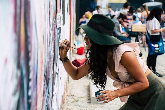 Woman Paint A Wall